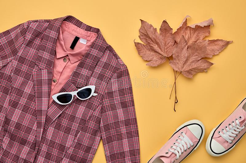 Autumn Fashion Clothes Flat lay, Leaf. Fall Outfit. Autumn Arrives. Fall fashion Clothes Accessories Outfit, Maple Leaf. Creative minimal Flat lay. Trendy pink stock image