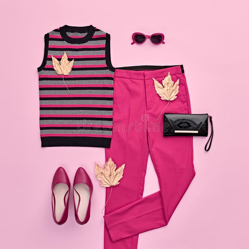 Autumn Fashion Clothes Flat lay, Leaf. Fall Outfit. Autumn Arrives. Fashion Lady Clothes fall Outfit. Trendy top, pink trousers. Stylish Handbag, Glamour heels stock photo