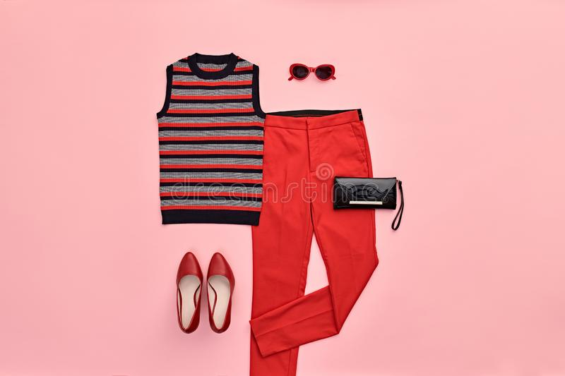 Autumn Fashion Clothes Flat lay, Leaf. Fall Outfit. Autumn Arrives. Fashion Lady Clothes fall Outfit. Trendy top, red trousers. Stylish Handbag, Glamour heels stock photography