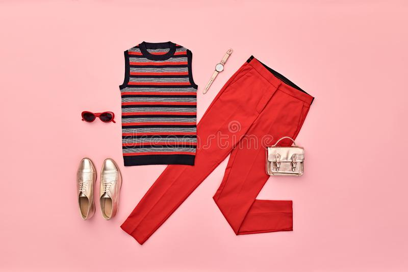 Autumn Fashion Clothes Flat lay, Leaf. Fall Outfit. Autumn Arrives. Fashion Lady Clothes fall Outfit. Trendy top, red trousers. Stylish Handbag, Glamour gold royalty free stock images