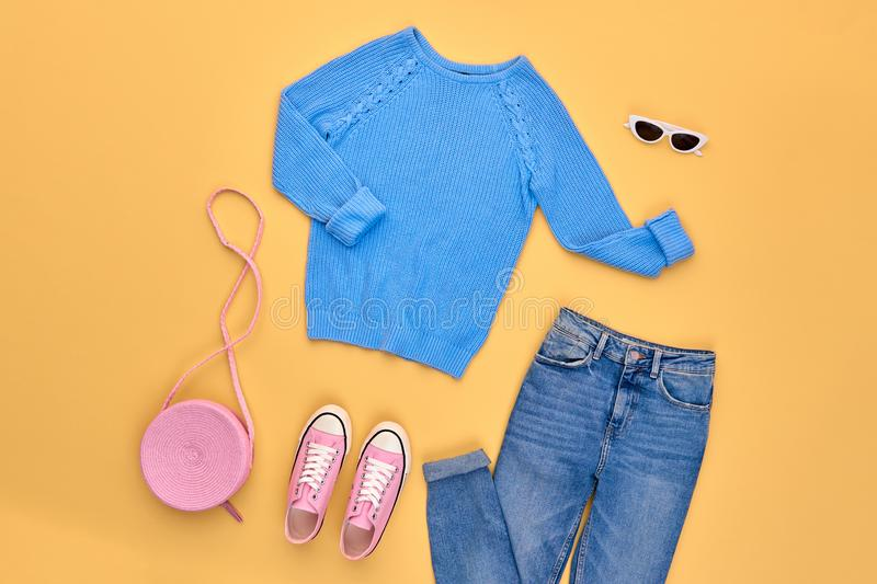 Autumn Fashion Clothes Outfit Flat lay. Maple Leaf. Fall fashion Flat lay. Trendy blue jumper, Stylish jeans, hipster sneakers, autumn Maple Leaf. Creative Woman royalty free stock image