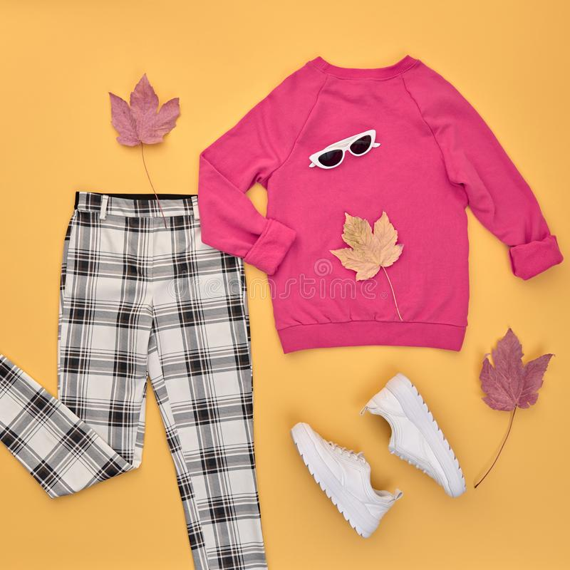Autumn Fashion Clothes Outfit Flat lay. Maple Leaf. Fall fashion Flat lay. Trendy pink jumper, Stylish trousers, hipster sneakers, autumn Maple Leaf. Creative royalty free stock images