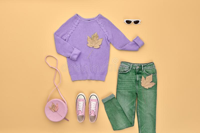 Autumn Fashion Clothes Outfit Flat lay. Maple Leaf. Fall fashion Flat lay. Trendy purple jumper, Stylish trousers, hipster sneakers, autumn Maple Leaf. Creative royalty free stock images