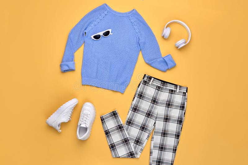 Autumn Fashion Hipster DJ Clothes Outfit Flat lay. Hipster DJ trendy colorful autumn Outfit. Fall fashion Flat lay. Blue jumper, Stylish sneakers, headphones royalty free stock images