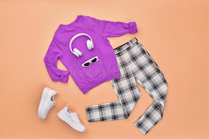 Autumn Fashion Hipster DJ Clothes Outfit Flat lay. Hipster DJ trendy colorful autumn Outfit. Fall fashion Flat lay. Purple jumper, Stylish sneakers, headphones royalty free stock photos