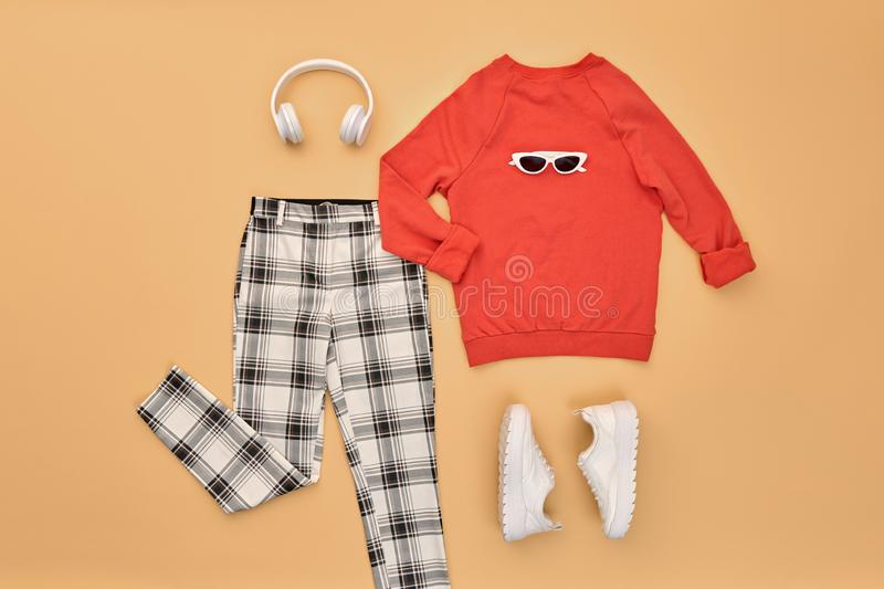 Autumn Fashion Hipster DJ Clothes Outfit Flat lay. Hipster DJ trendy colorful autumn Outfit. Fall fashion Flat lay. Red jumper, Stylish sneakers, headphones stock photography