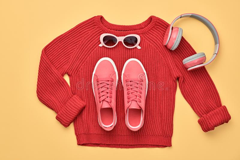 Autumn Fashion Hipster DJ Clothes Outfit Flat lay. Hipster DJ trendy colorful autumn Outfit. Fall fashion minimal Flat lay. Red jumper, Stylish sneakers stock images