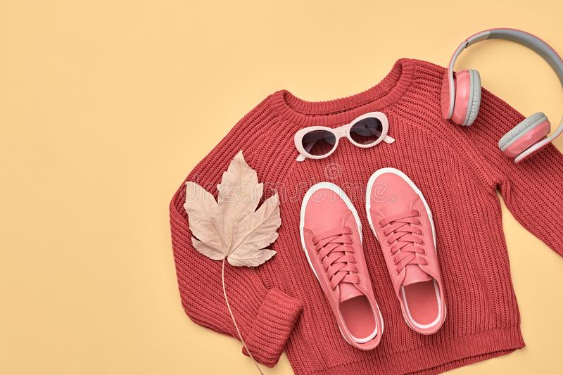 Autumn Fashion Hipster DJ Clothes Outfit Flat lay. Hipster DJ trendy colorful autumn Outfit. Fall fashion minimal Flat lay. Red jumper, Stylish sneakers royalty free stock photos
