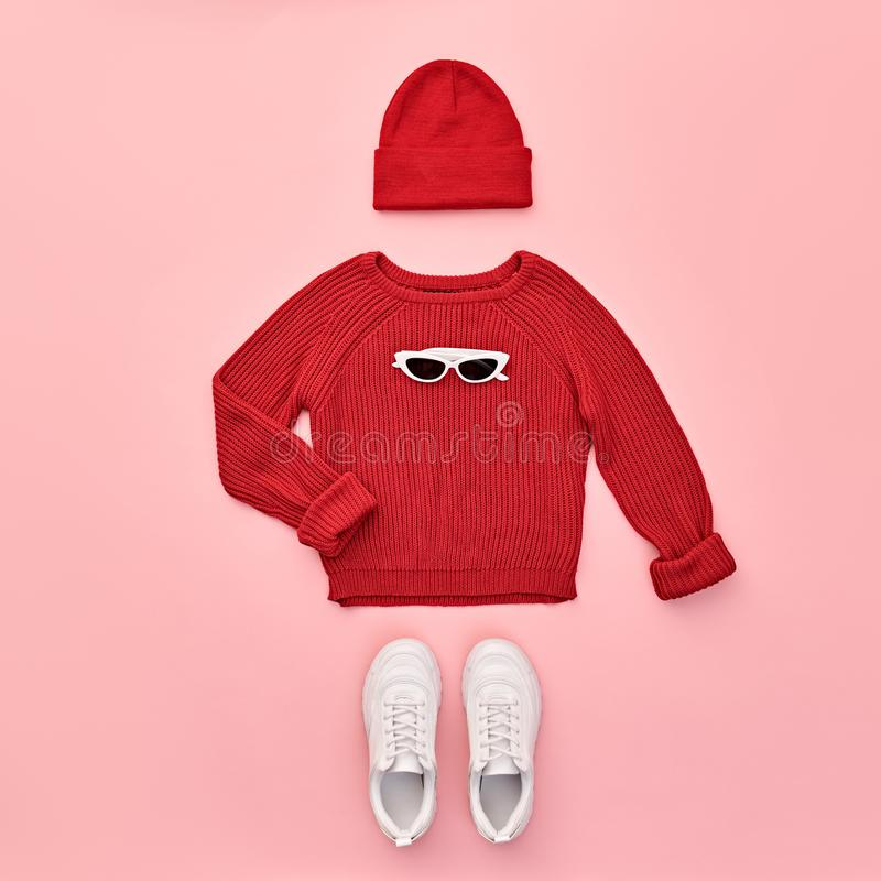 Autumn Fashion Hipster DJ Clothes Outfit Flat lay. Hipster Girl trendy colorful autumn Outfit. Fall fashion Flat lay. Red jumper, Stylish sneakers, Beanie Hat royalty free stock photography