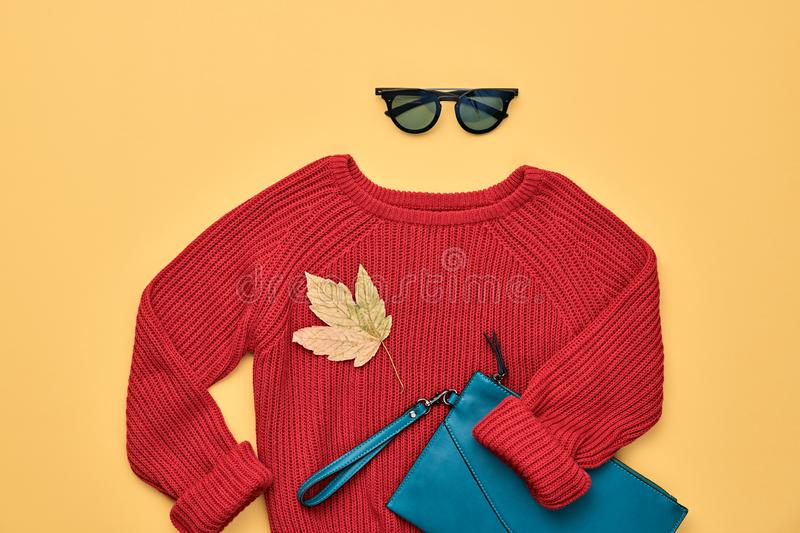 Autumn Fashion Hipster DJ Clothes Outfit Flat lay. Hipster Girl trendy colorful autumn Outfit. Fall fashion Flat lay. Red jumper, Stylish sunglasses, maple leaf stock photos