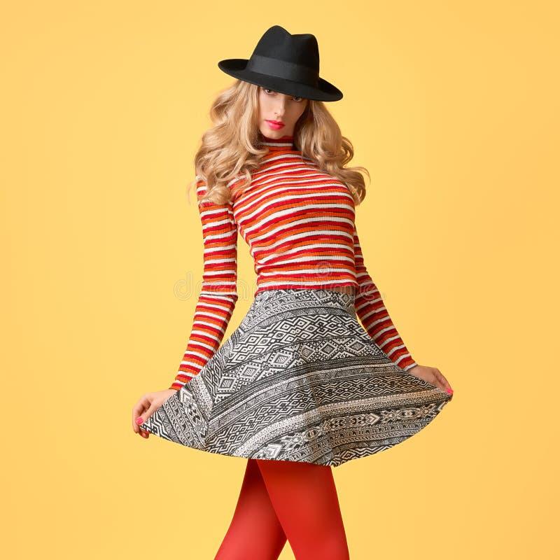 Autumn Fashion. Model Woman in Stylish Fall Outfit. Autumn Fashion. Model Woman in Fall Outfit Having Fun. Stylish Sweater Trendy autumn Hat, Red fashion royalty free stock photography