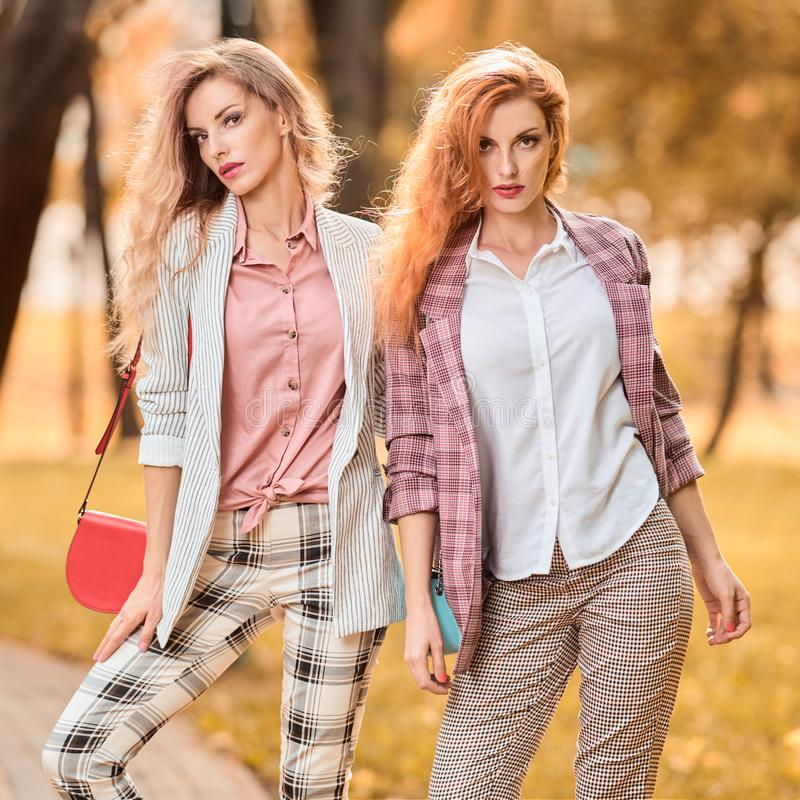 Fall Fashion Outdoor. Woman in park, Autumn outfit royalty free stock photo