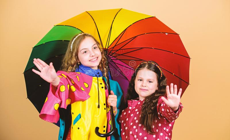 Autumn fashion. rain protection. Rainbow. cheerful hipster children, sisterhood. happy little girls with colorful. Umbrella. family bonds. Little girls in royalty free stock photo