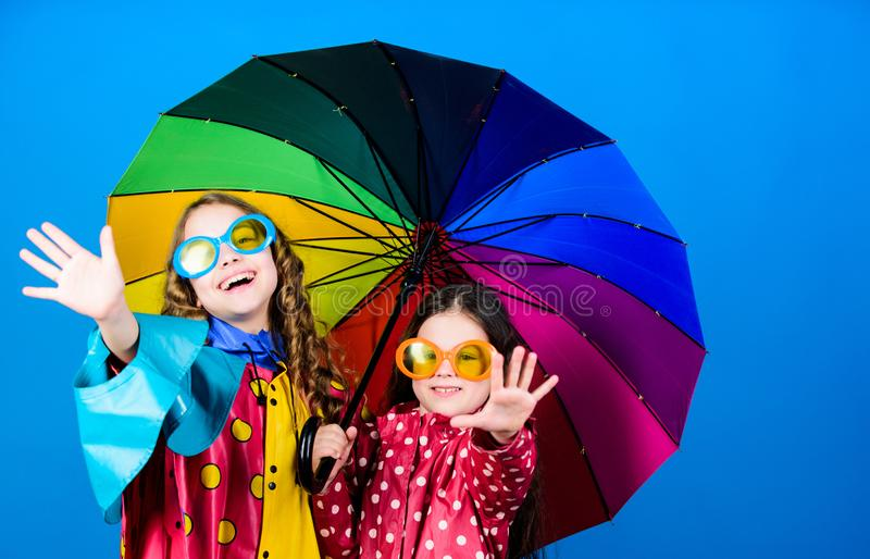 Autumn fashion. rain protection. Rainbow. cheerful hipster children, sisterhood. happy small girls with colorful. Umbrella. family bonds. Small girls in stock photos