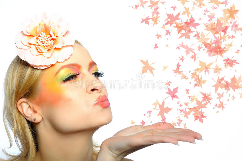 Autumn Fashion Woman Blowing Autumn Leafs Royalty Free Stock Photography