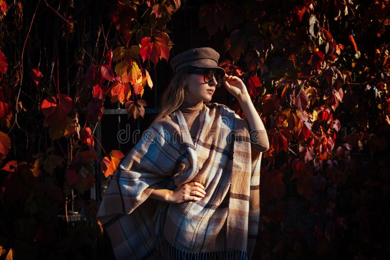 Autumn fashion. Young woman wearing stylish outfit outdoors. Clothing and accessories. Beauty portrait stock photos