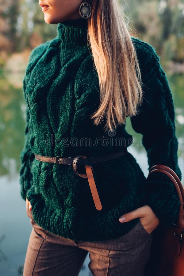 Autumn fashion. Young woman wearing stylish outfit and holding handbag outdoors. Clothing and accessories royalty free stock photo