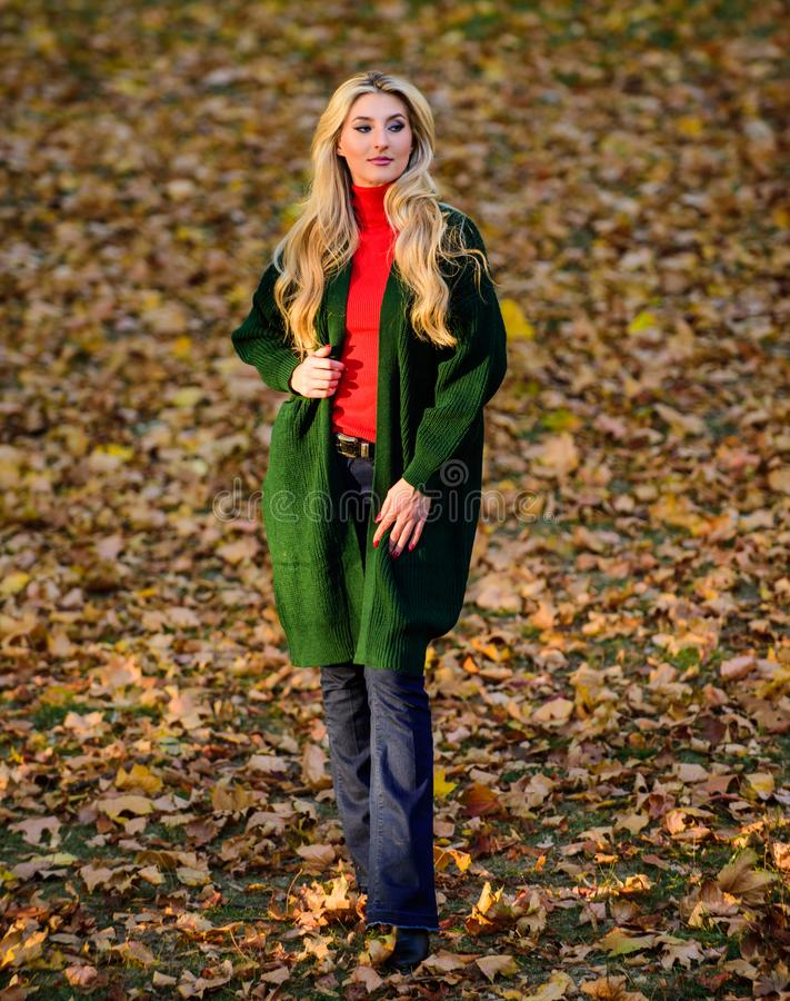 Autumn fashionable cardigan. Girl stylish outfit with soft wool or cashmere cardigan. Feel so warm and comfortable. Woman wear long wool cardigan while walk in royalty free stock photo