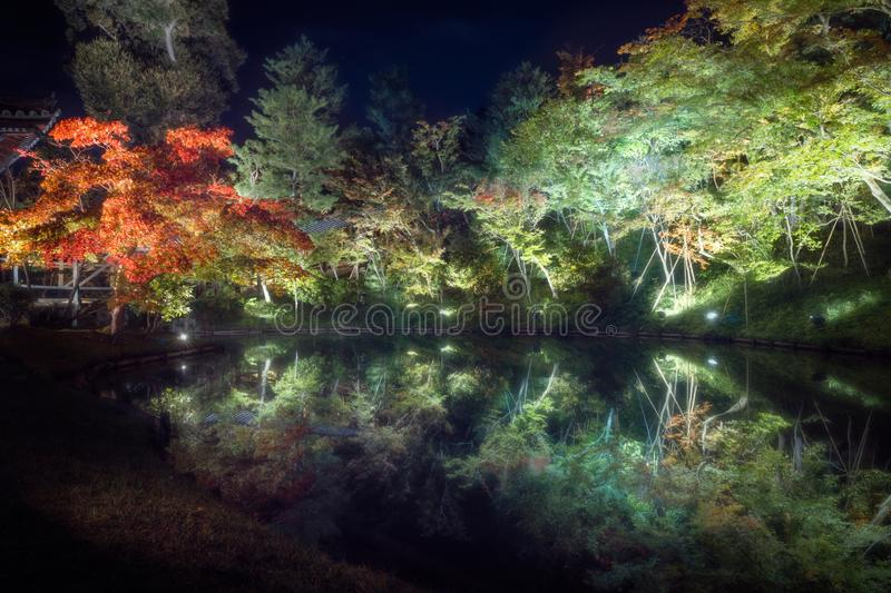 Autumn Festival in the tranquil gardens of Kodaiji Buddhist Temple in Gion. Trees mirrored in the water at the Autumn Festival in the tranquil gardens of Kodaiji stock photography