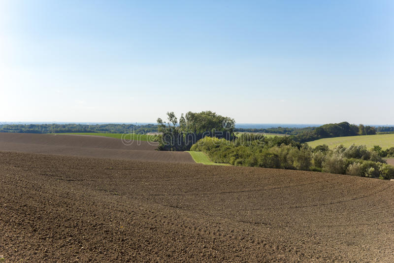 Ploughed autumn fields stock photos