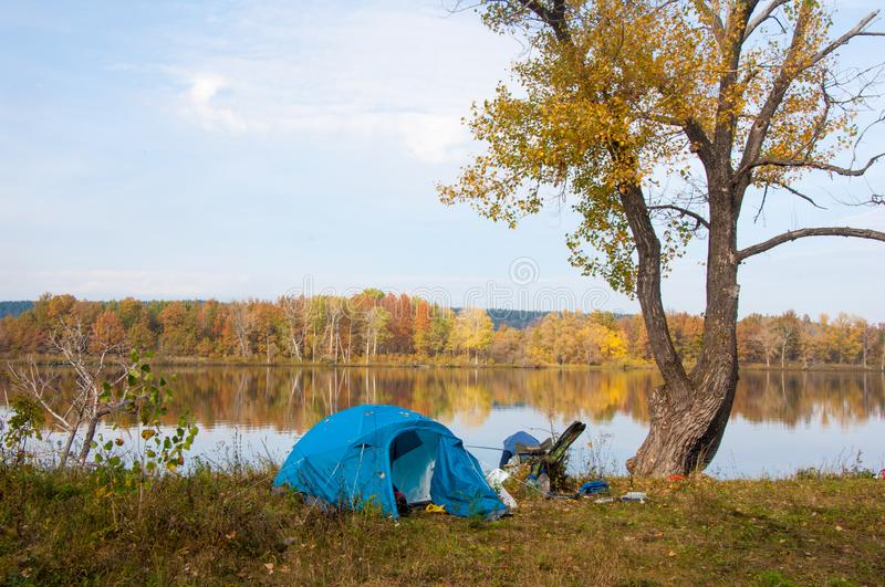Autumn. Fishing. blue tent. Calm lake. The quiet atmosphere of t. He day royalty free stock image