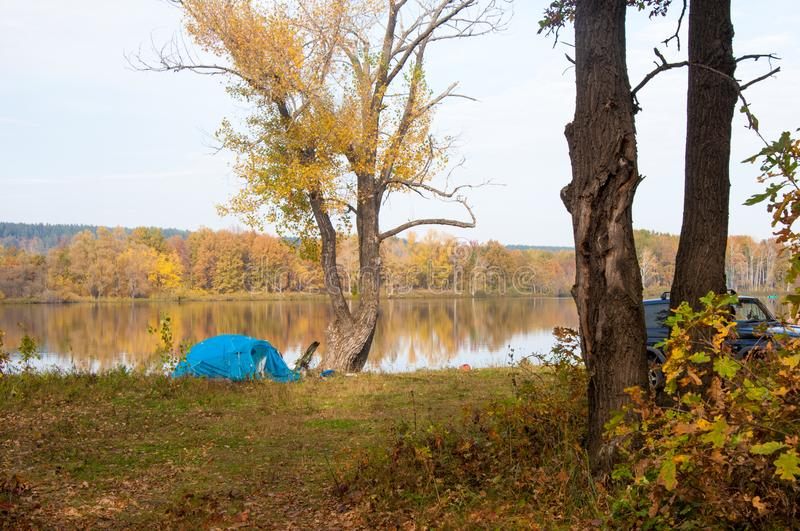 Autumn. Fishing. blue tent. Calm lake. The quiet atmosphere of t. He day stock photos