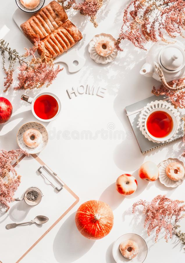 Free Autumn Flat Lay With Word Home, Cozy Tea Setting, Cakes , Flowers, Pumpkin And Clipboard On White Desktop Background. Top View. Royalty Free Stock Images - 161048129