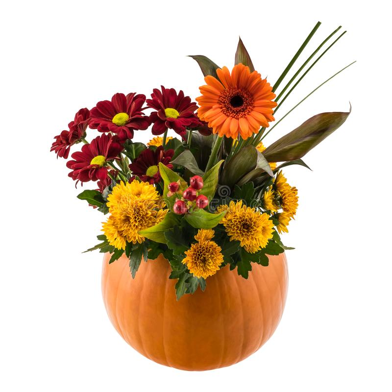 Autumn floral composition in a pumpkin vase royalty free stock images