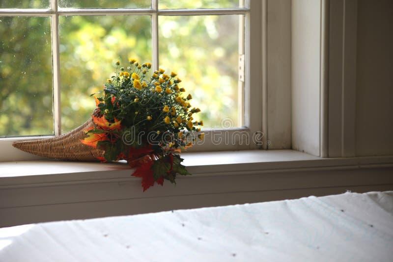 Autumn flower bouquet on interior window sill royalty free stock photo