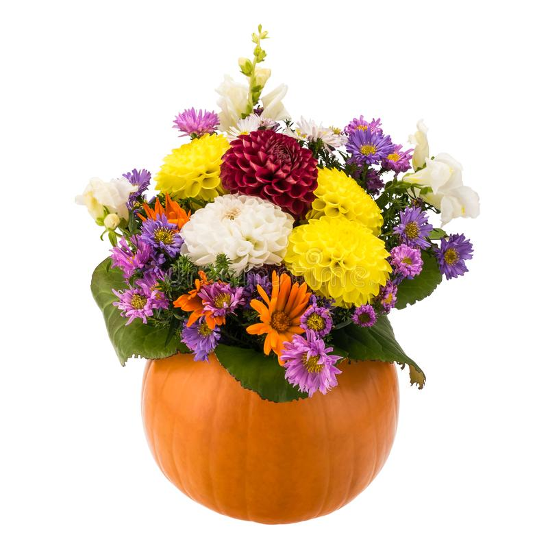 Autumn flower composition in a pumpkin vase stock photos