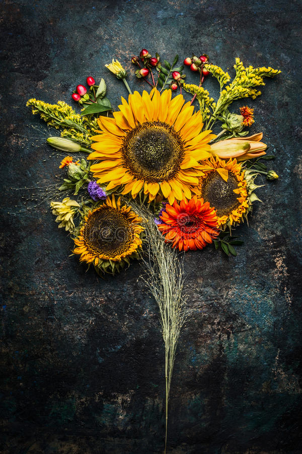 Autumn flowers bunch with sunflowers on dark vintage background stock photography