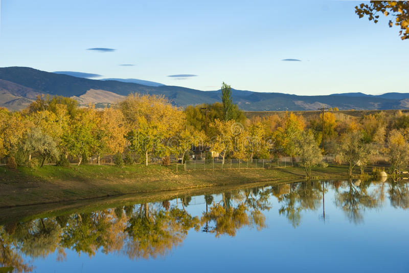 Autumn Foliage Reflections in Still Lake stock photography