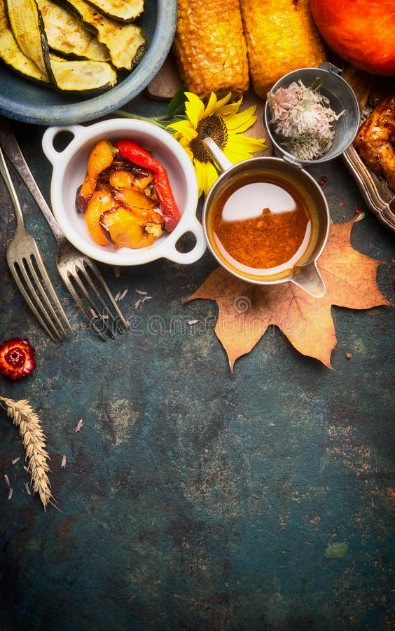Autumn food with roasted vegetables and sauce, top view royalty free stock photography