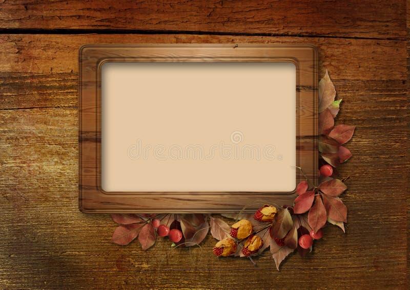 Autumn frame on wooden background
