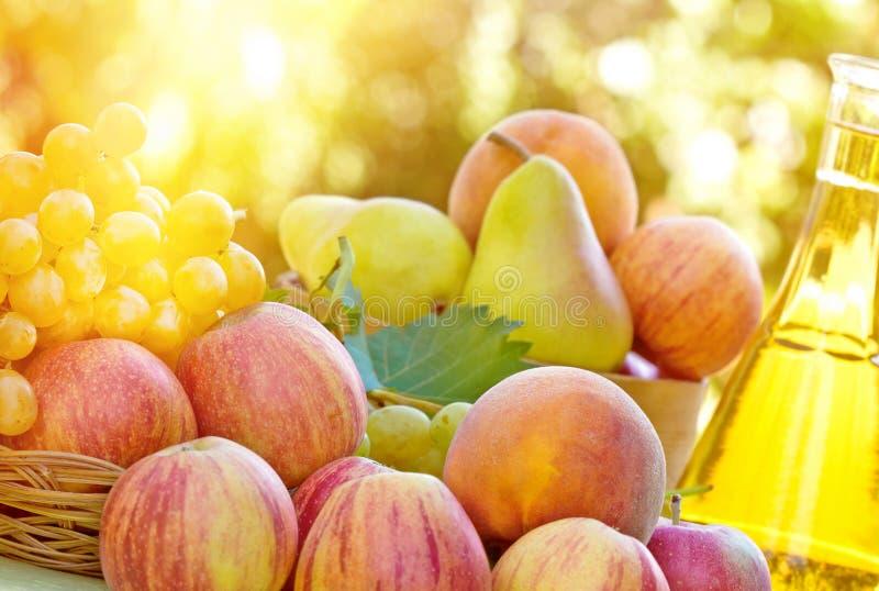 Autumn fruit and wine royalty free stock image
