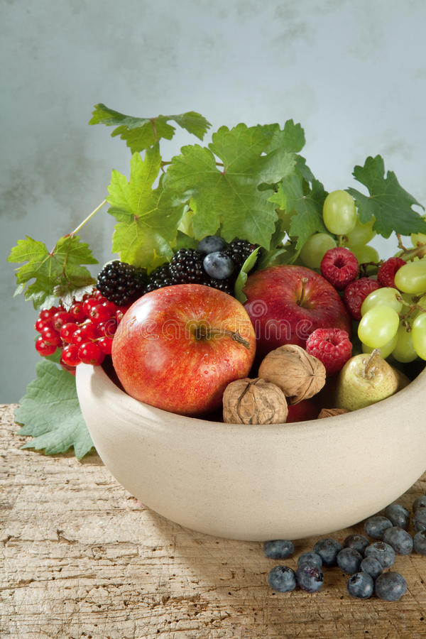 Autumn fruits in a bowl stock images