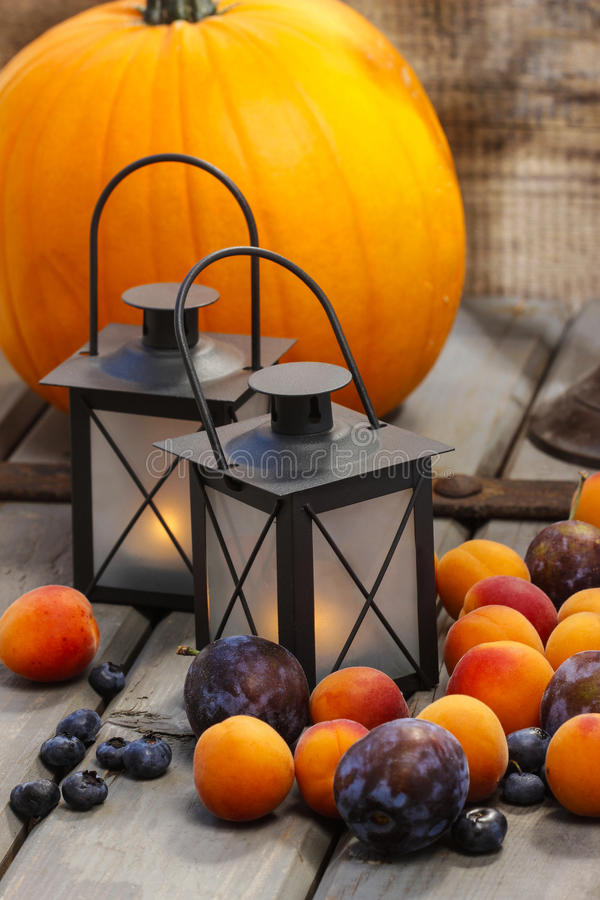 Autumn fruits and traditional lanterns. On wooden table. Seasonal decoration stock photos