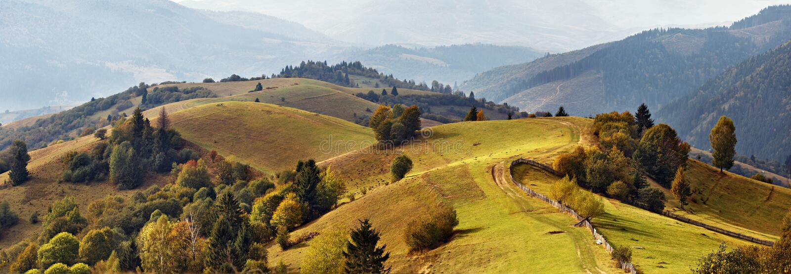Autumn garden in mountains. Fall on the hills royalty free stock image
