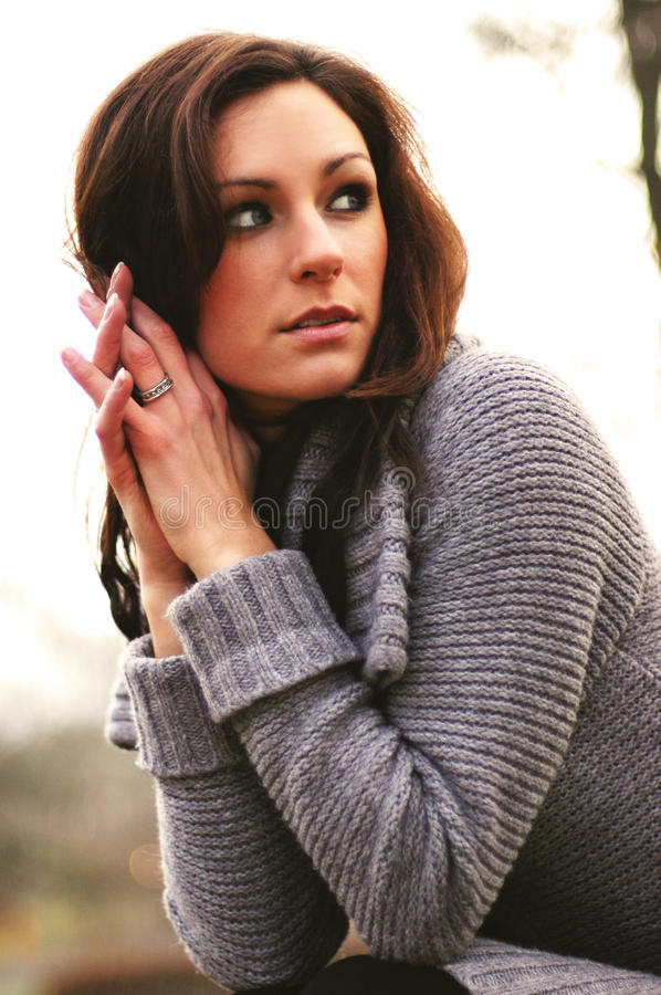 Autumn girl. Woman with warm wool coat in the autumn stock photo
