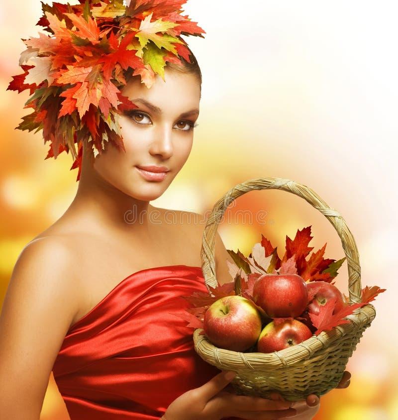Autumn Girl. Beautiful Autumn Girl with Apples royalty free stock photo