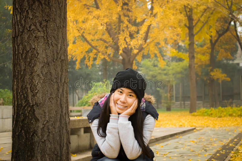 teenage girl with yellow leaves in autumn stock photo