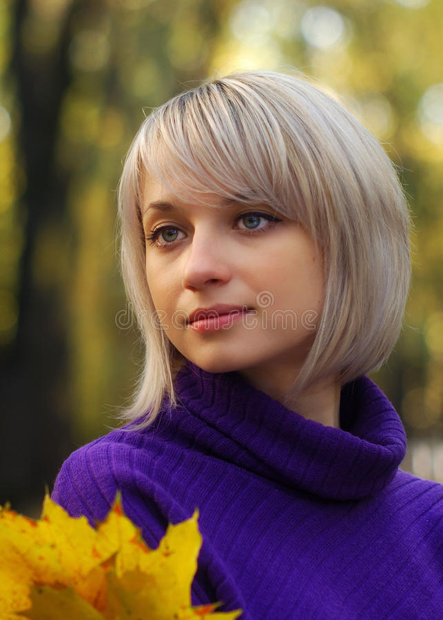 Free Autumn Girl With Maple Leaves Royalty Free Stock Image - 12777806