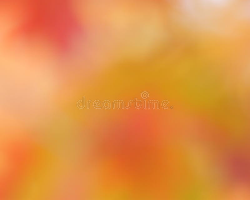 Autumn gold abstract background. Blurred sun light - bokeh. Orange, brown and yellow dots royalty free stock images