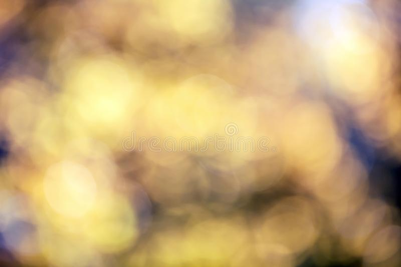 Autumn golden bokeh lights defocused lens flare abstract art background stock photos