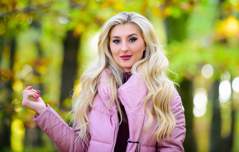 Autumn hair care is important so as to avoid dry frizzy hair. Cold blonde concept. How to repair bleached hair fast and. Safely. Girl fashionable blonde walk in stock photo