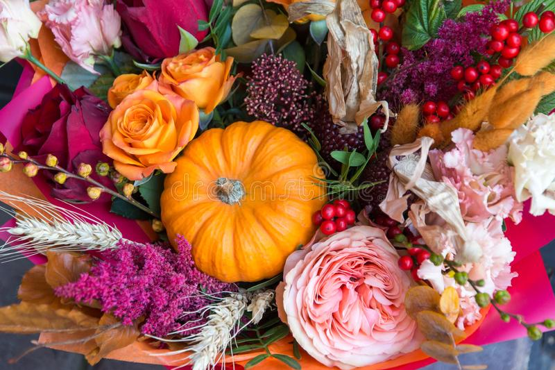 Autumn halloween bouquet with pumpkin close up. Flowers background. Autumn halloween bouquet, composition with pumpkin close up. Flowers floral background stock photos