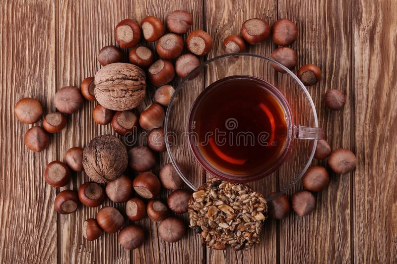 Autumn harvest. nuts on a dark recycled wood background royalty free stock photography