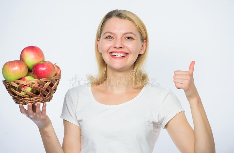 Autumn harvest. Spring seasonal fruit. Happy woman eating apple. farming concept. healthy teeth. orchard, gardener girl. With apple basket. vitamin and dieting royalty free stock photos
