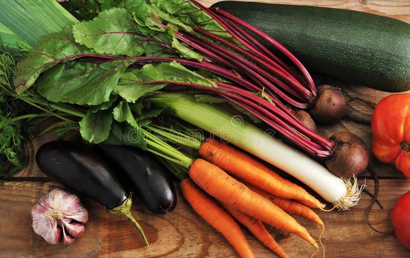 autumn harvest - zucchini, eggplant, onions, leeks, beets, garlic, tomatoes stock photos
