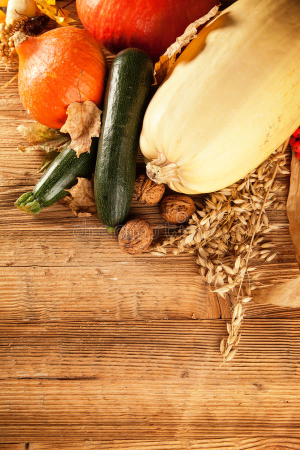 Autumn harvested fruit and vegetable on wood royalty free stock photos